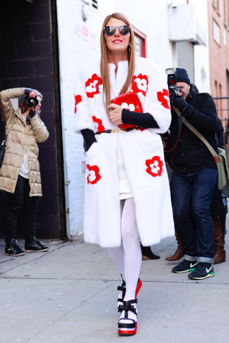 Per usual, Anna Dello Russo drew the eye in a floral-dotted statement coat and black and red platforms.