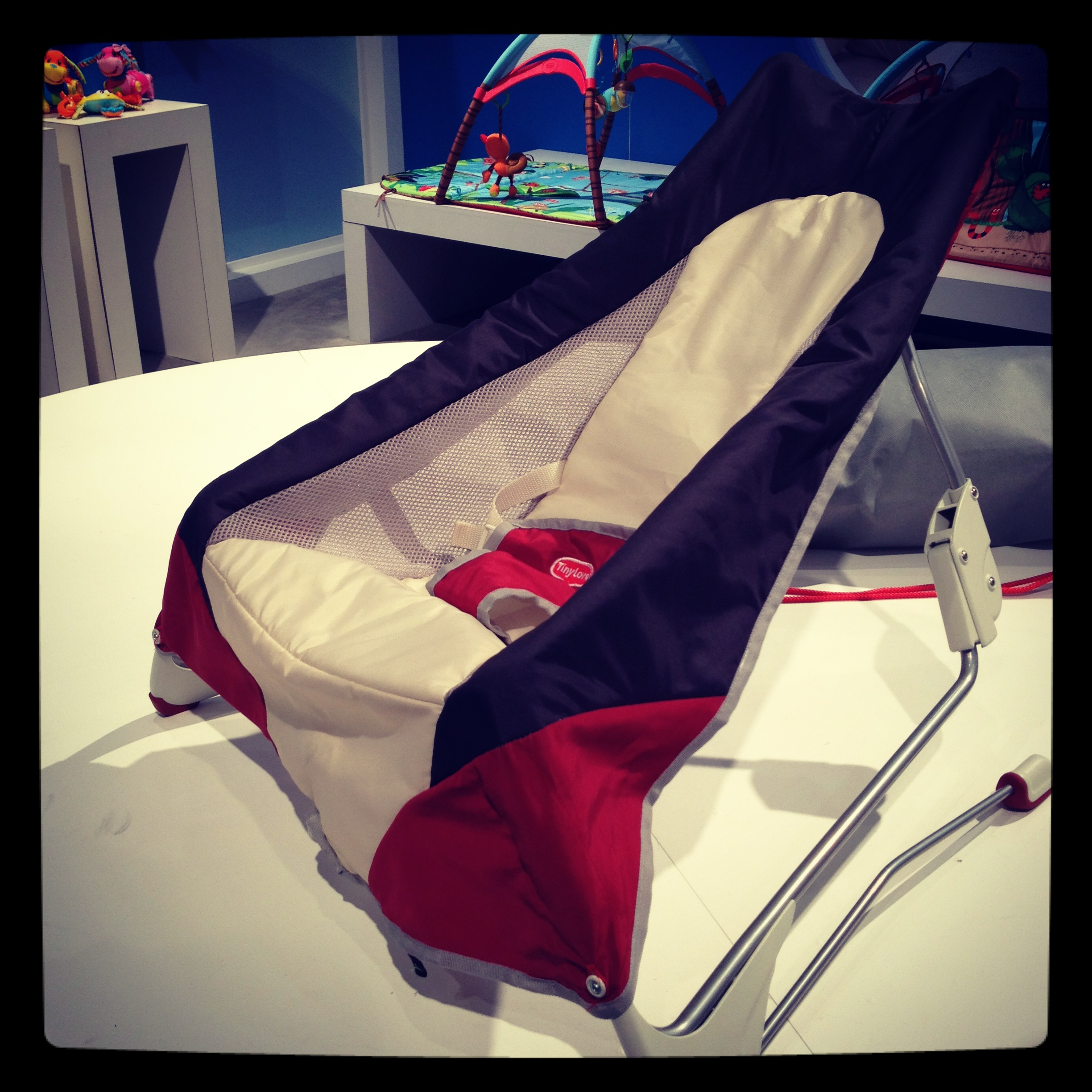 Tiny Love's Take Along Bouncer is sleek, soft, and ready to be packed for travel.