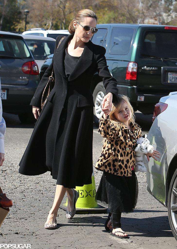 Angelina Jolie held Vivienne's hand.
