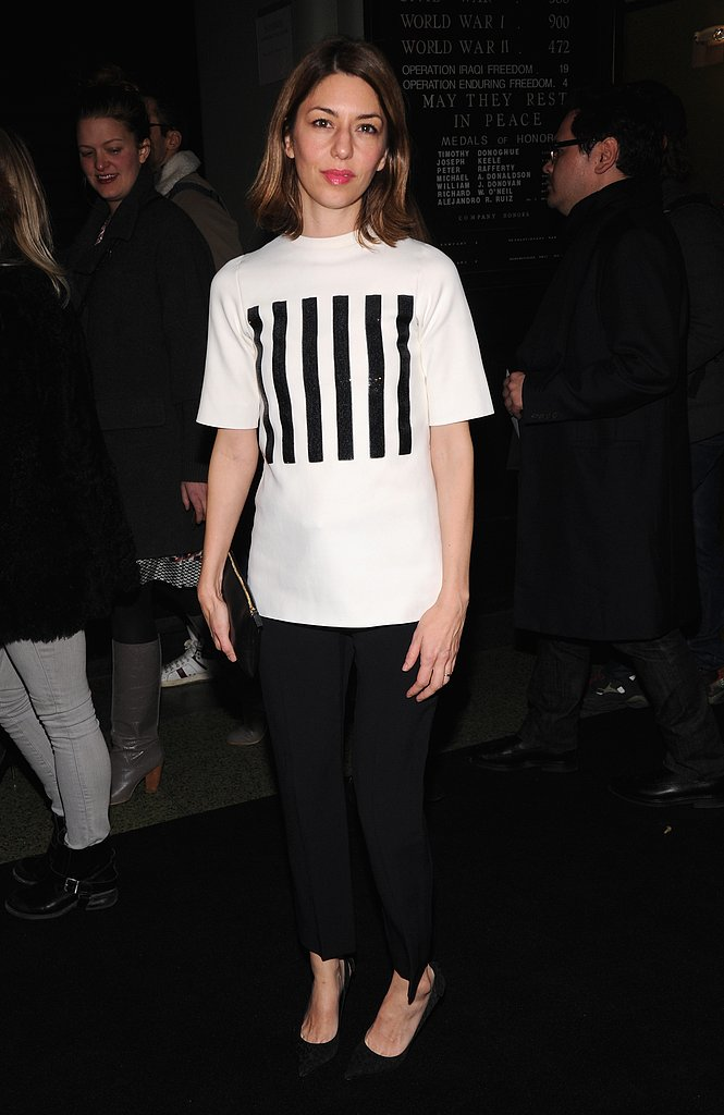 Sofia Coppola sat front row at Marc Jacobs in a striped tee and black cropped trousers.