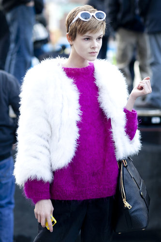 A modern mod moment, thanks to a brilliant pop of color and white fur jacket.