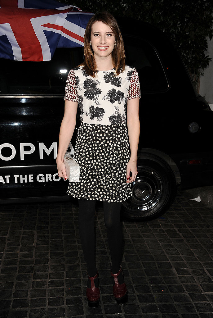 Emma Roberts's floral cap-sleeved dress was a cool-girl choice, especially paired with black tights and oxblood-hued boots.
