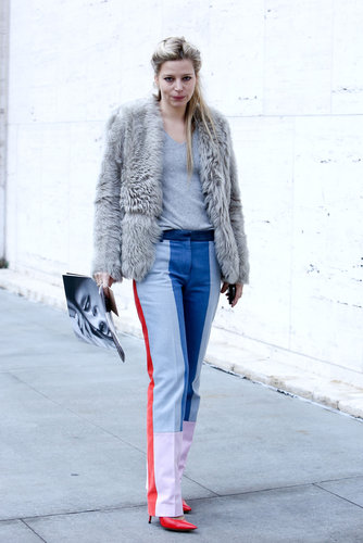 Colorblocked pants and bright heels get tempered with an understated fur and t-shirt.