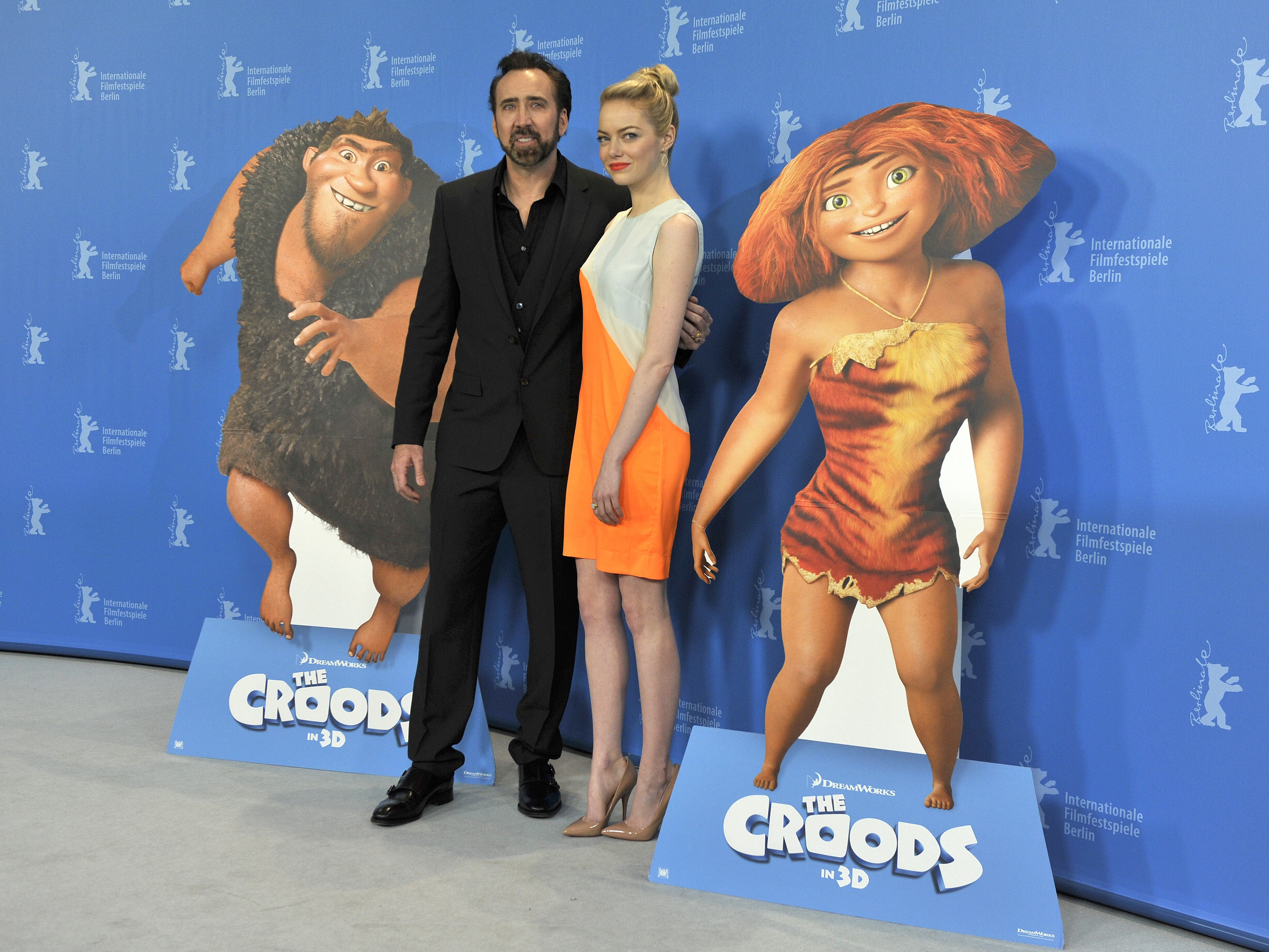 Emma Stone posed with Nicolas Cage at The Croods photocall in Berlin.