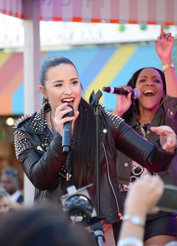Demi Lovato performed a small concert for the store's launch.