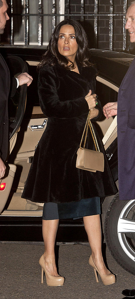Salma Hayek attended a London Fashion Week kickoff party at 10 Downing Street in a fur coat and nude accessories, including Saint Laurent platform pumps.