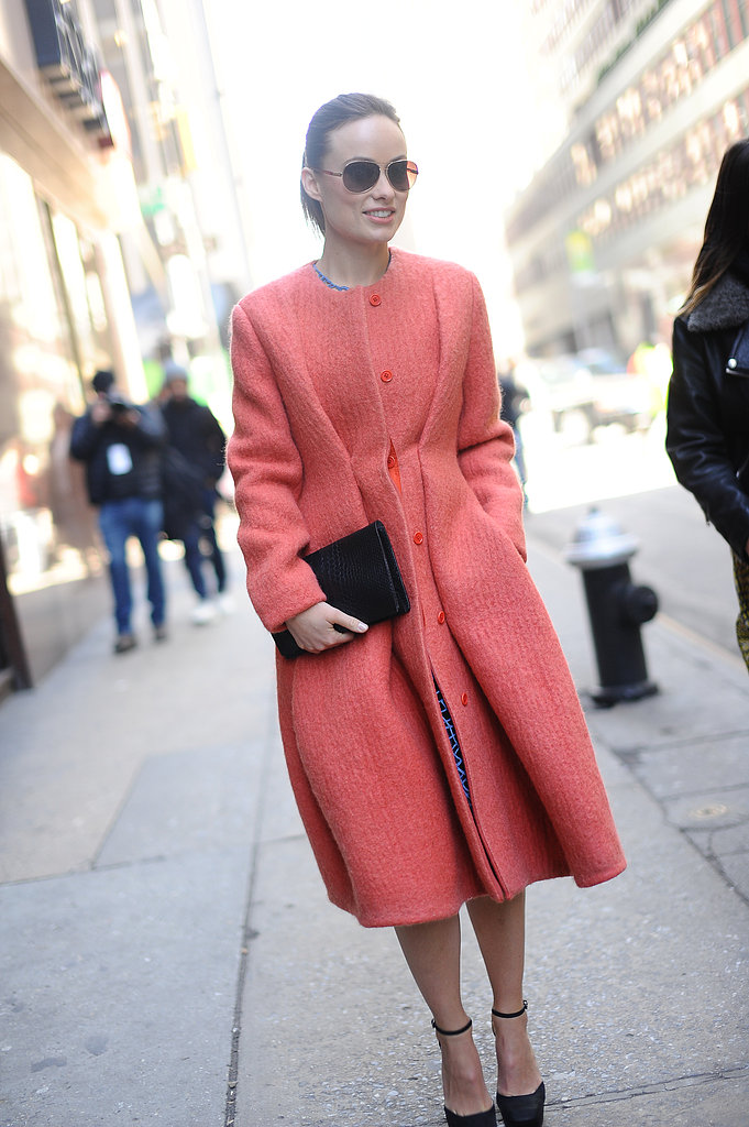 Olivia Wilde was on her way to Calvin Klein in an ultrafemme, cinched and pleated coat.