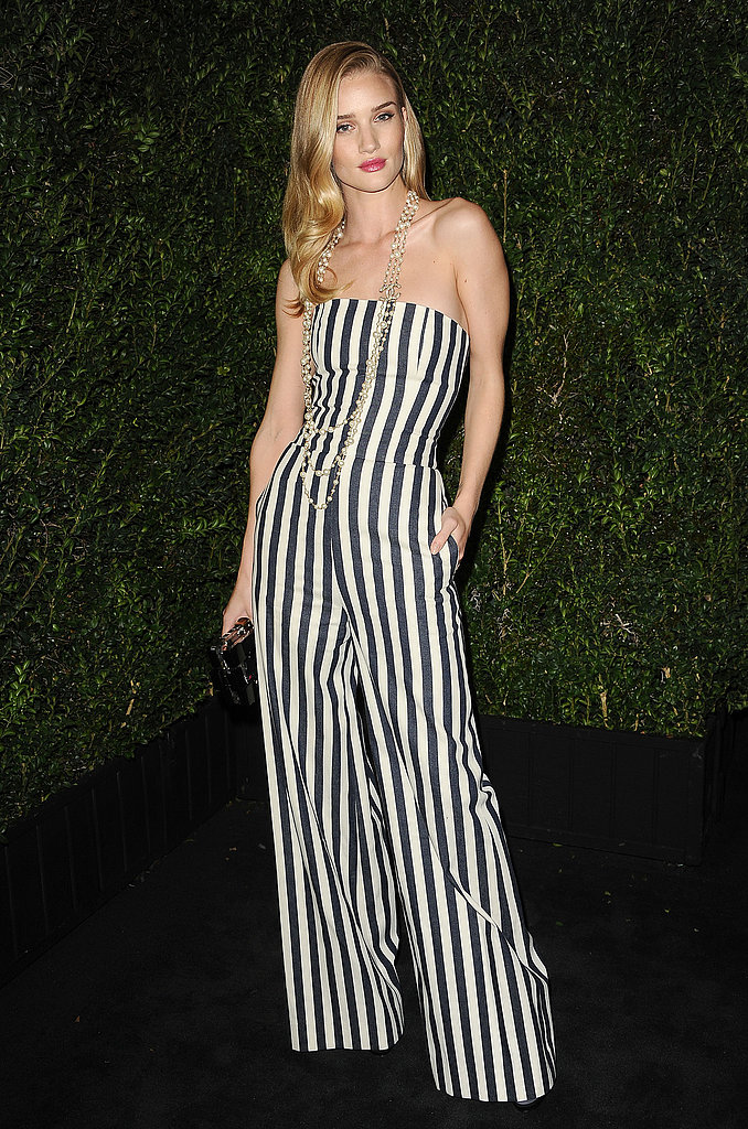Rosie Huntington-Whiteley looked amazing in a striped jumpsuit at Chanel's party.