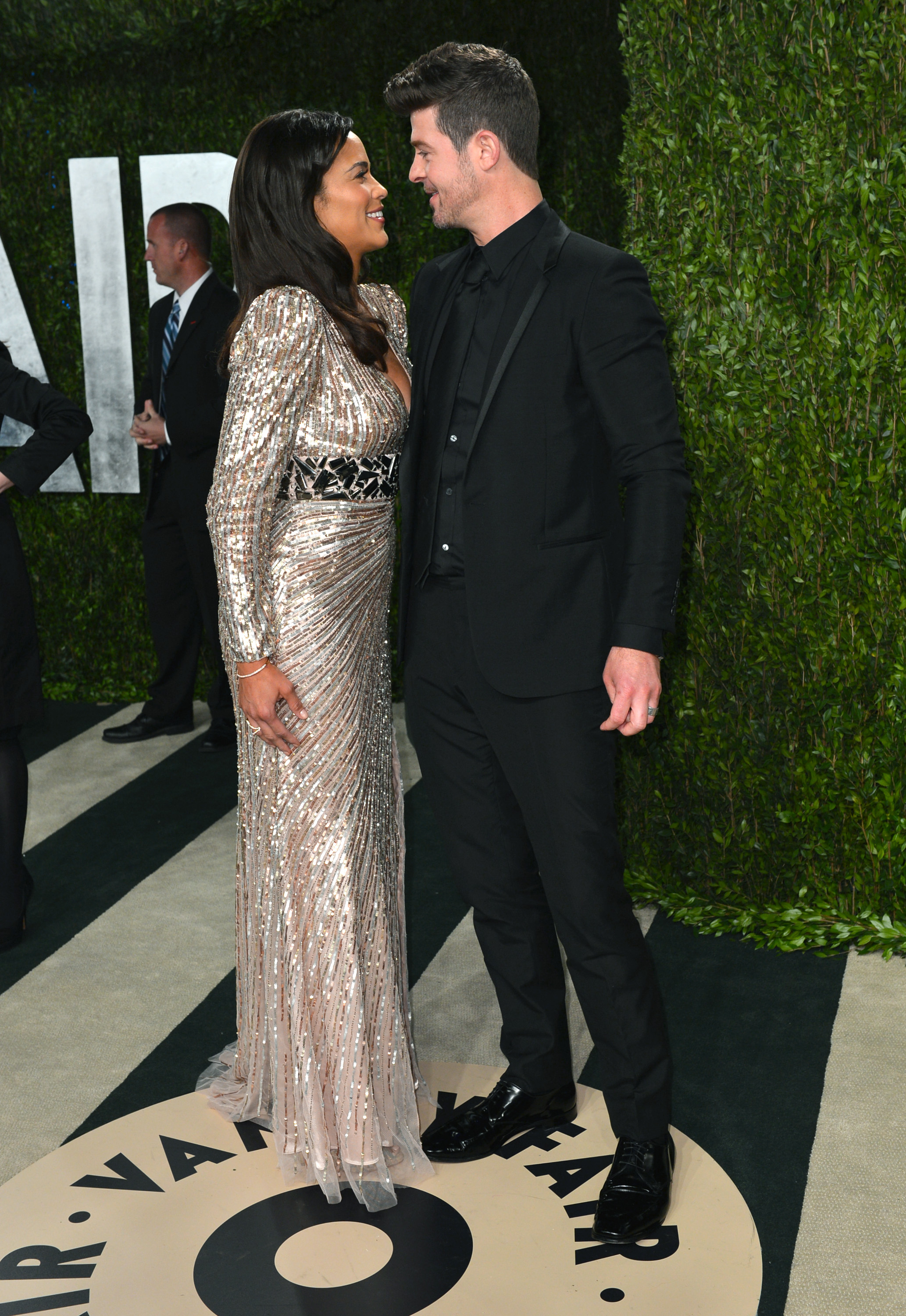 Paula Patton and Robin Thicke shared a loving look as they arrived at the Vanity Fair Oscar party on Sunday night.