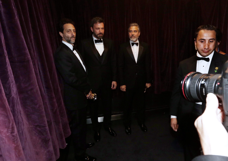 Grant Heslov, Ben Affleck, and George Clooney backstage at the 2013 Oscars.