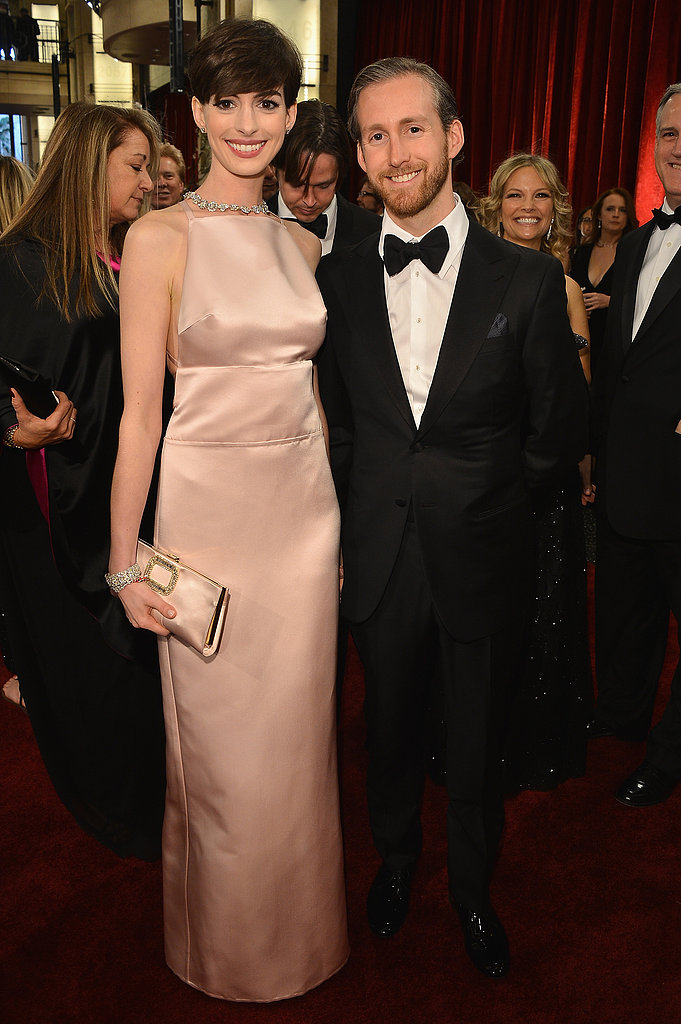 Anne Hathaway and Adam Shulman on the red carpet at the Oscars 2013.