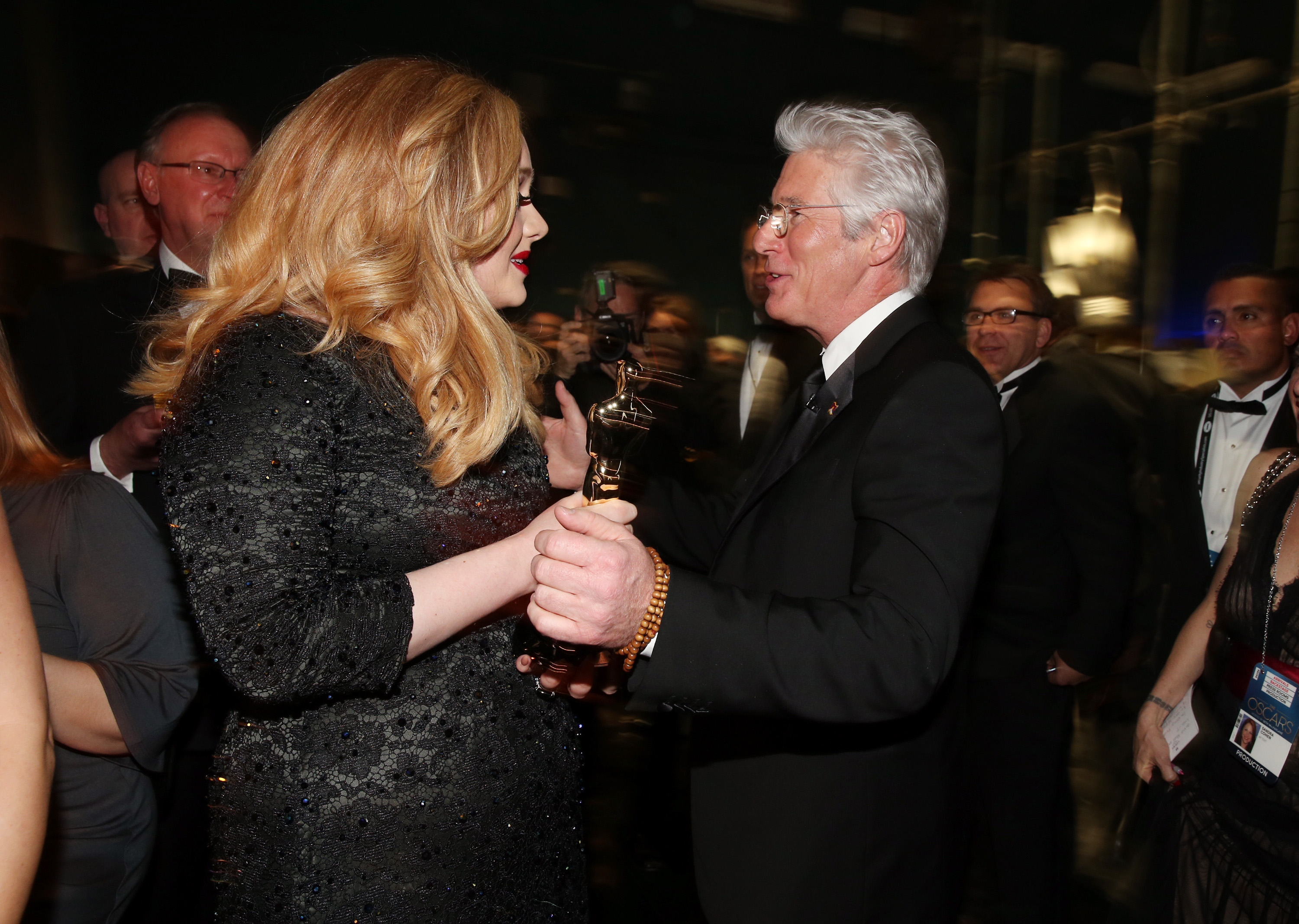 Adele Adkins and Richard Gere backstag