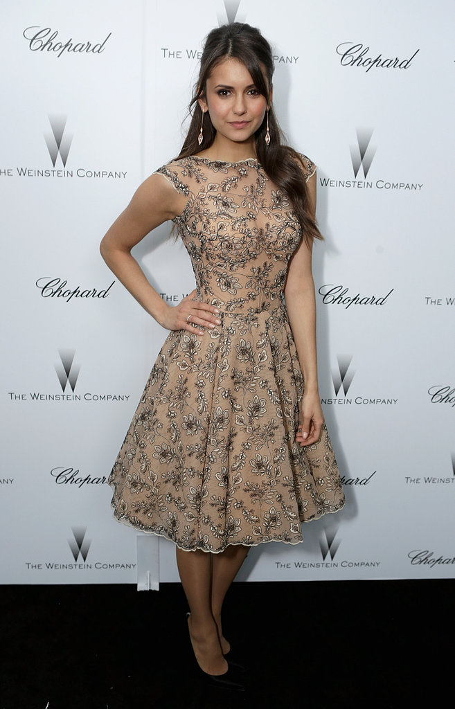 While most of the attendees stuck with black, Nina Dobrev surprised in a beautiful embellished fit-and-flare Zuhair Murad dress at Weinstein's pre-Oscars event.