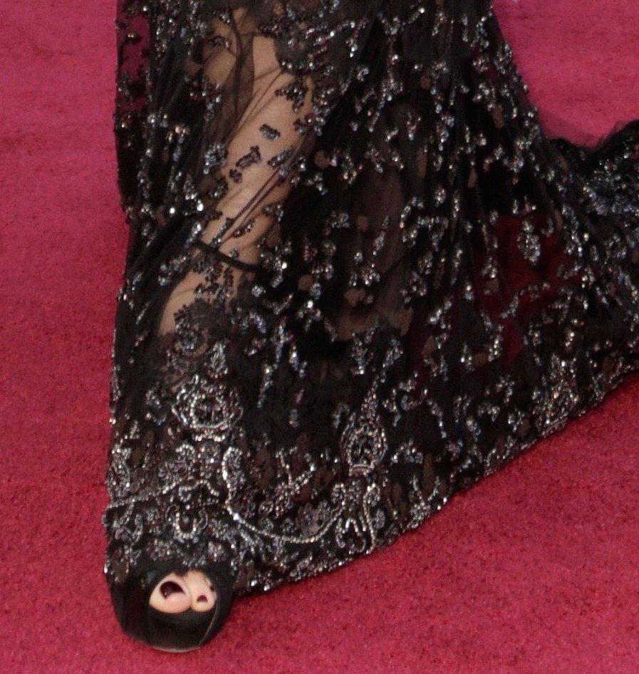 Sandra Bullock's embellished black Elie Saab gown didn't need much more than classic Jimmy Choo peep-toes.