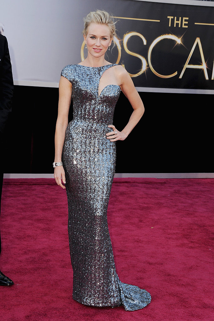 Naomi Watts shined in a silver-sequined Armani Privé featuring a perfectly placed cutout bodice against an already body-con silhouette.
