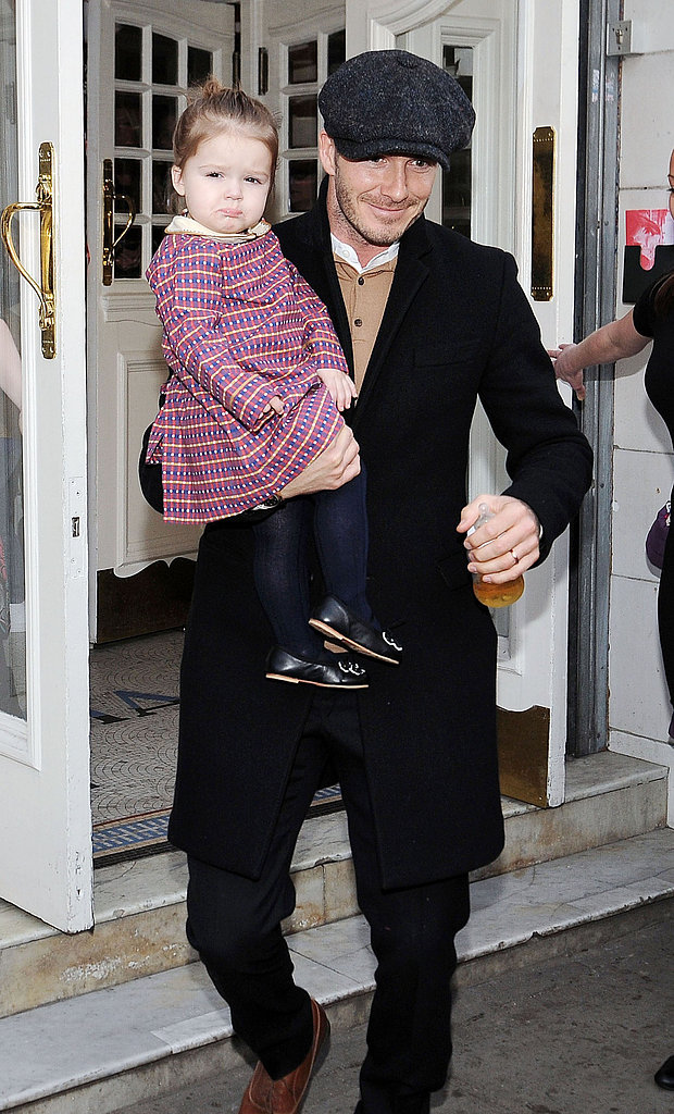 David Beckham held daughter Harper while having lunch with the family in Paris in February.