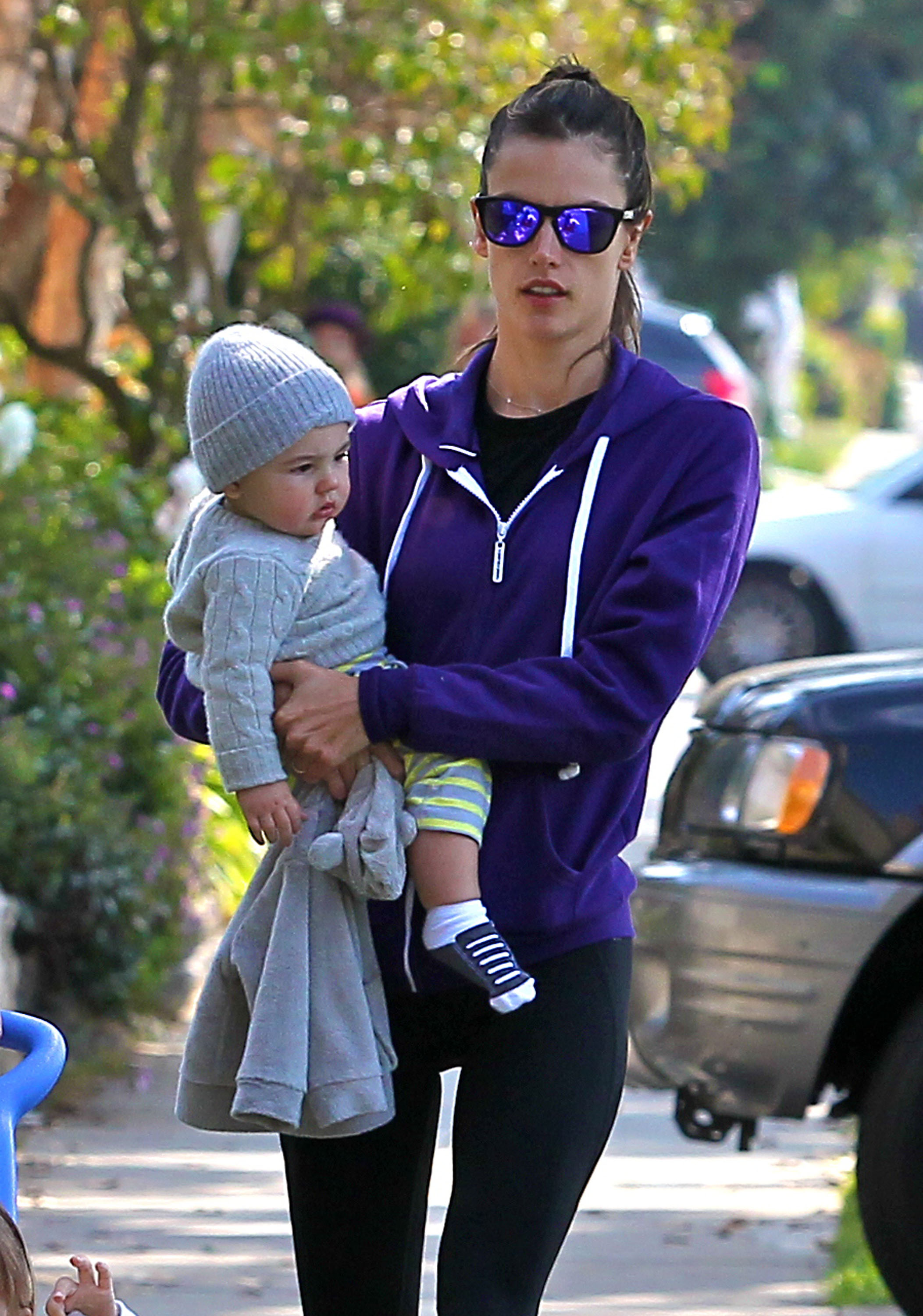 Alessandra Ambrosio wore purple shades as she carried baby boy Noah.