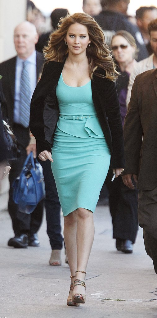 Jennifer Lawrence wore a tight turquoise dress as she made the award-season media rounds in LA in February.