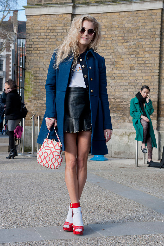 Red platforms and socks lent a pinup feel to a tougher, studded leather skirt.