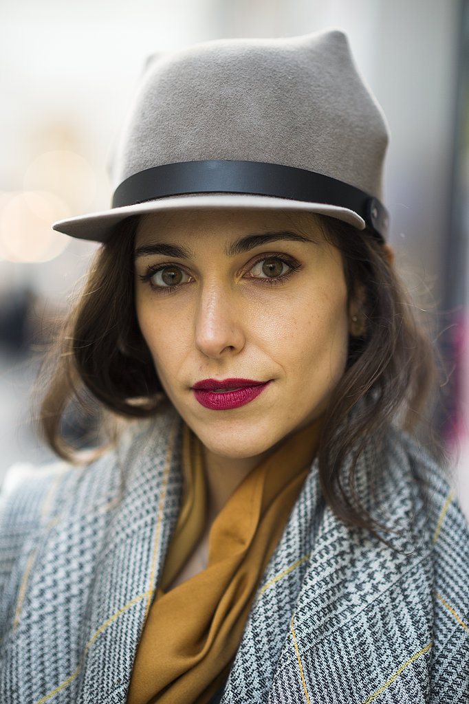 A mussy hairstyle looked fantastic with Melanie Innocenti's velvety red lipstick color. Source: Le 21ème   Adam Katz Sinding