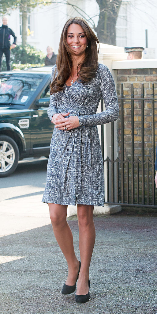 Kate Middleton wore a wrap dress and heels.