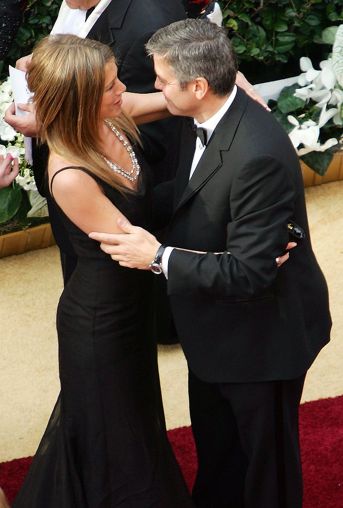 Jennifer Aniston stopped to chat with pal George Clooney on the red carpet at the 2006 Academy Awards. It was her first time attending the big award show.