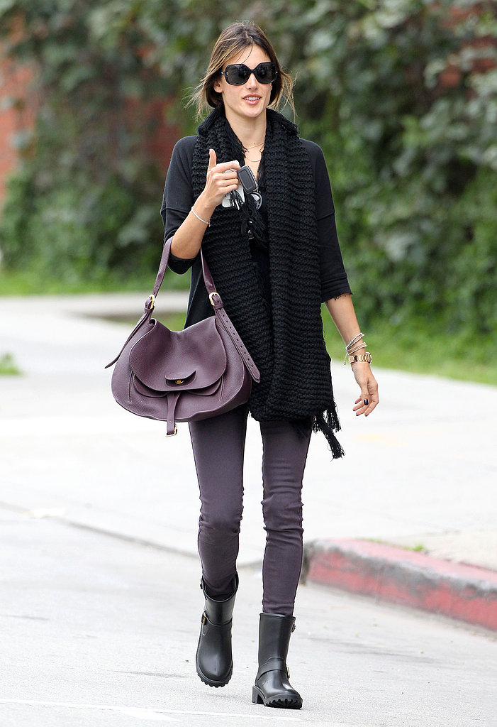 Alessandra Ambrosio dropped her daughter off at school in LA sporting purple skinny jeans, a coordinating purple bag, and these  däv moto rain boots ($59).