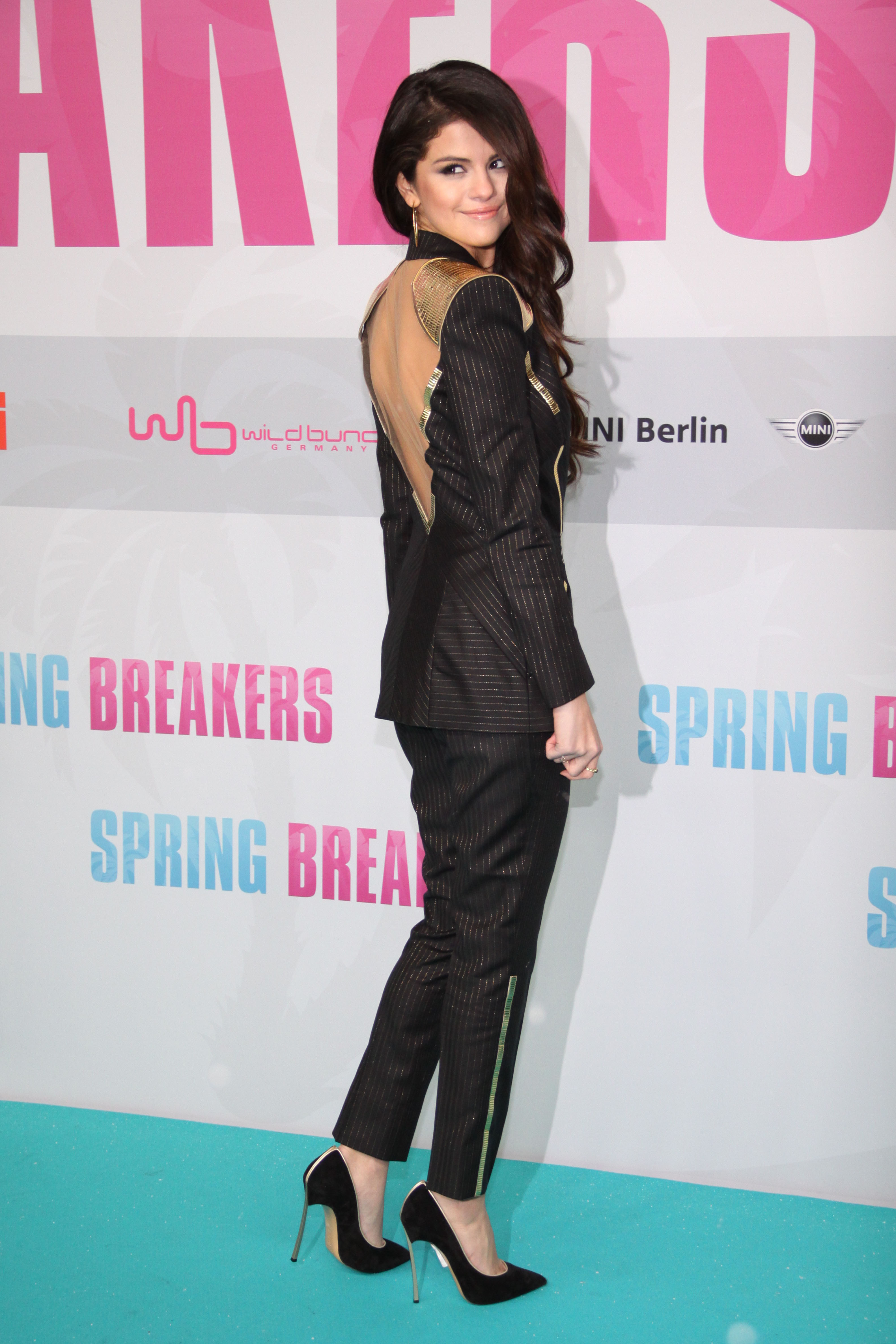 Check out the unexpected open back on Selena's suit.