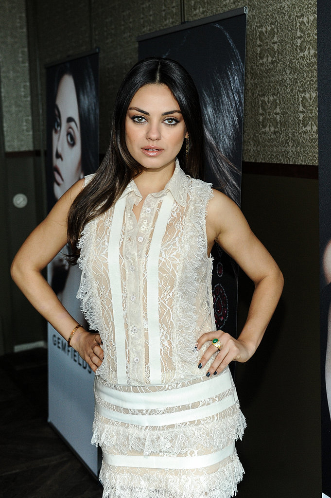 Mila Kunis posed in a lace dress in LA.