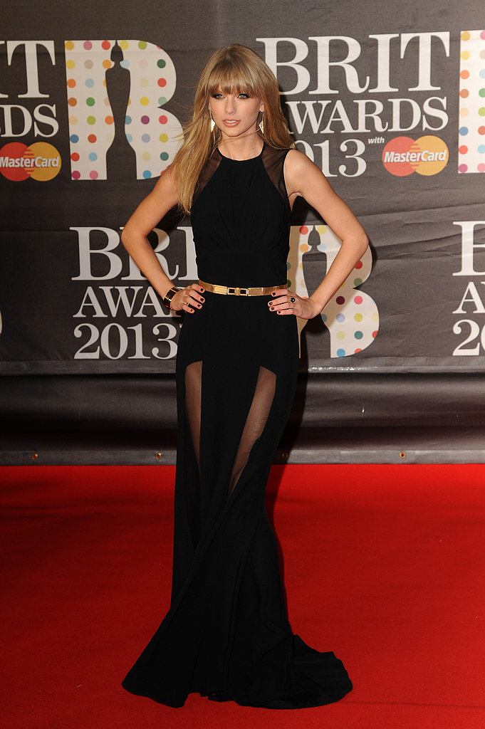 Taylor Swift wore a black Elie Saab gown with sheer panelling to the Brit Awards in London.