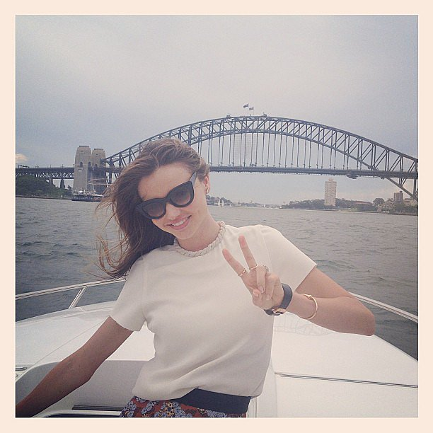 Miranda Kerr flashed a peace sign while cruising the Sydney Harbour. Source: Instagram user mirandakerrverified