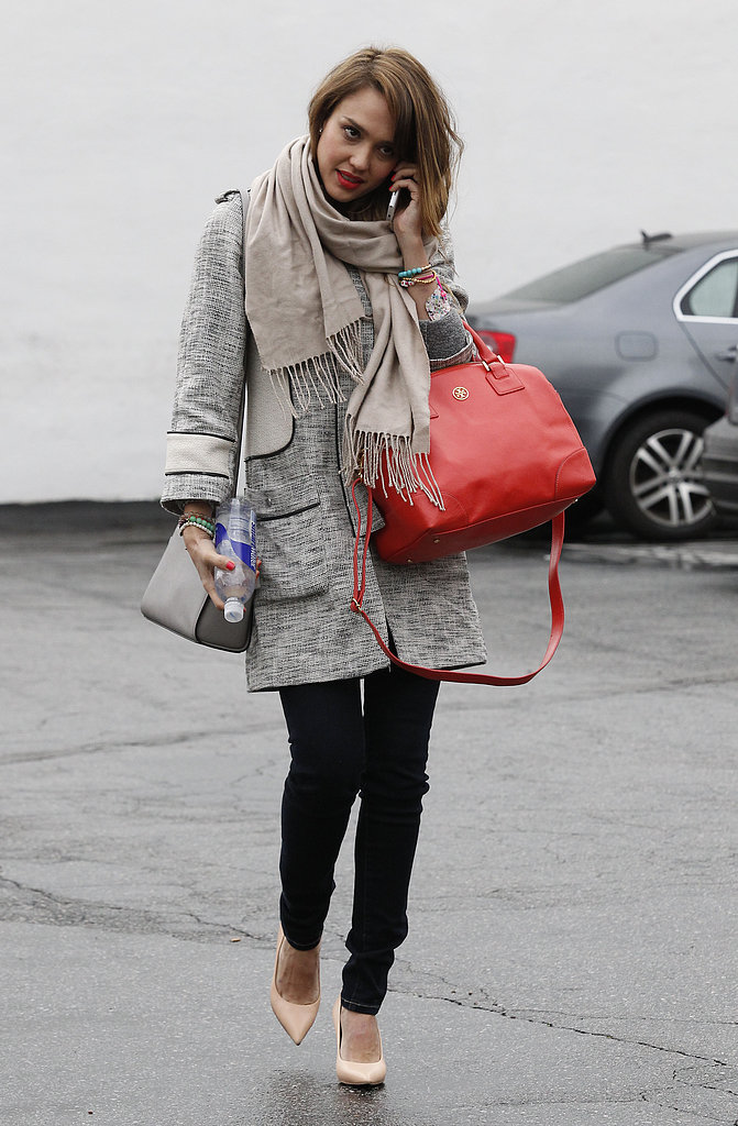 Jessica Alba was perfectly polished in a long tweed H&M coat, pointed nude pumps, and a vibrant red Tory Burch satchel while chatting on the phone in LA.