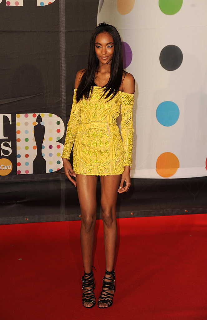 Jourdan Dunn delivered a pop of bright colour in her yellow off-the-shoulder minidress.
