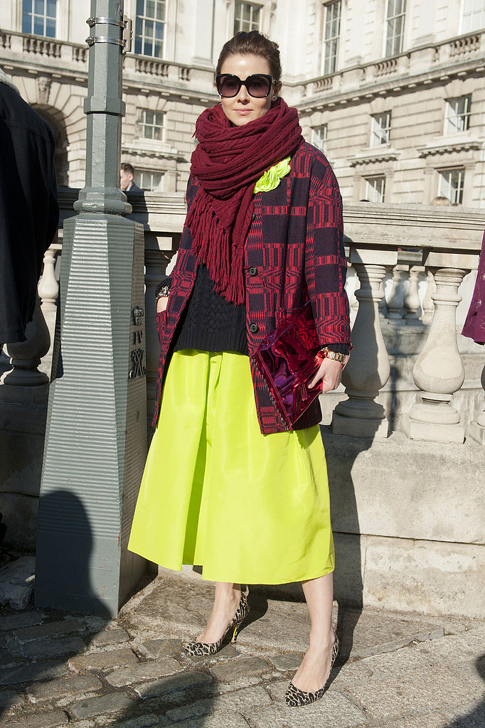This showgoer tempered her citron-hued Tibi skirt with a navy knit and burgundy layers.
