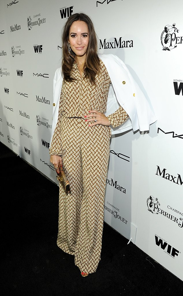 Louise Roe exuded an easy '70s glamour in a printed jumpsuit and a crisp white blazer at the Women in Film Pre-Oscar cocktail party.