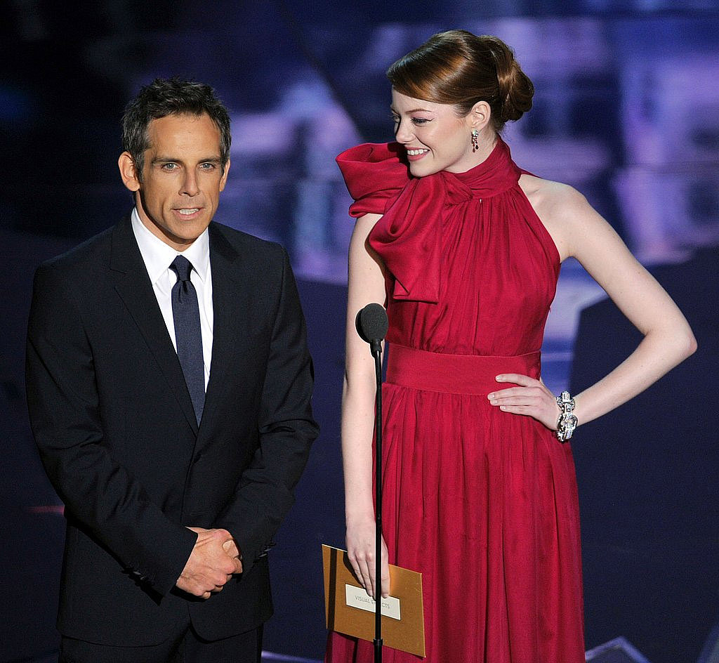 Emma Stone got animated on stage to present an Oscar with Ben Stiller at the 2012 show.