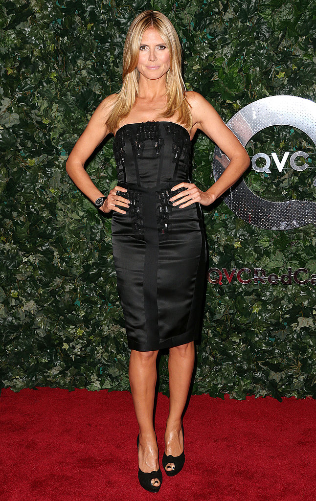 Heidi Klum kept it classic in a black strapless dress and black peep-toe pumps at the QVC party.