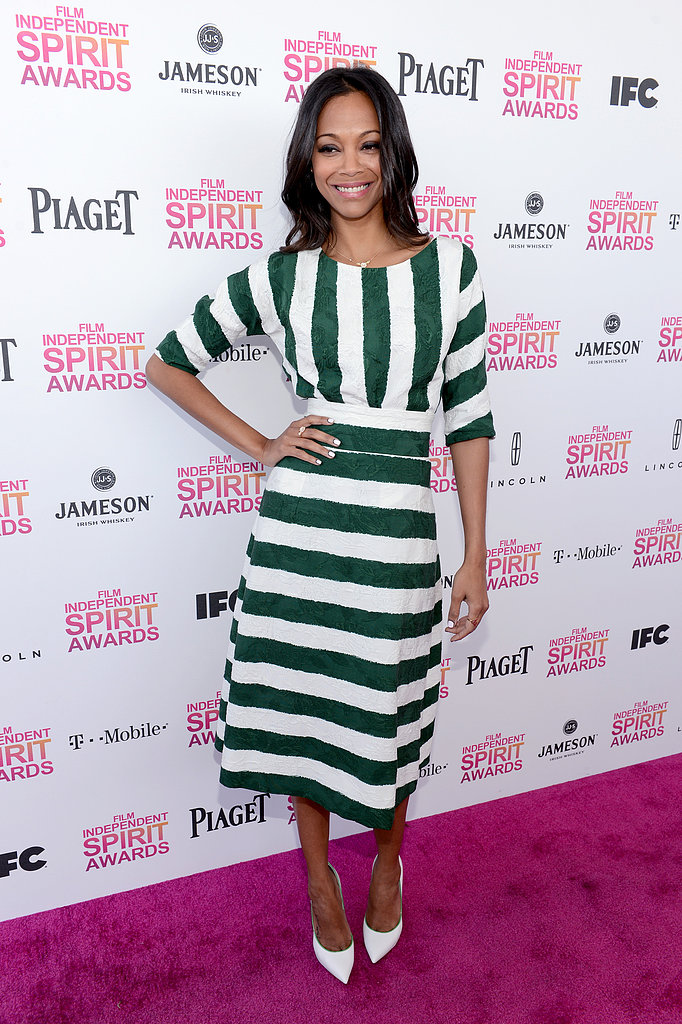 Zoe Saldana pulled off this loud striped Dolce & Gabbana Spring '13 look with the utmost ease. She kept her hair down and undone, and only added a stark pair of white pumps for the finish.