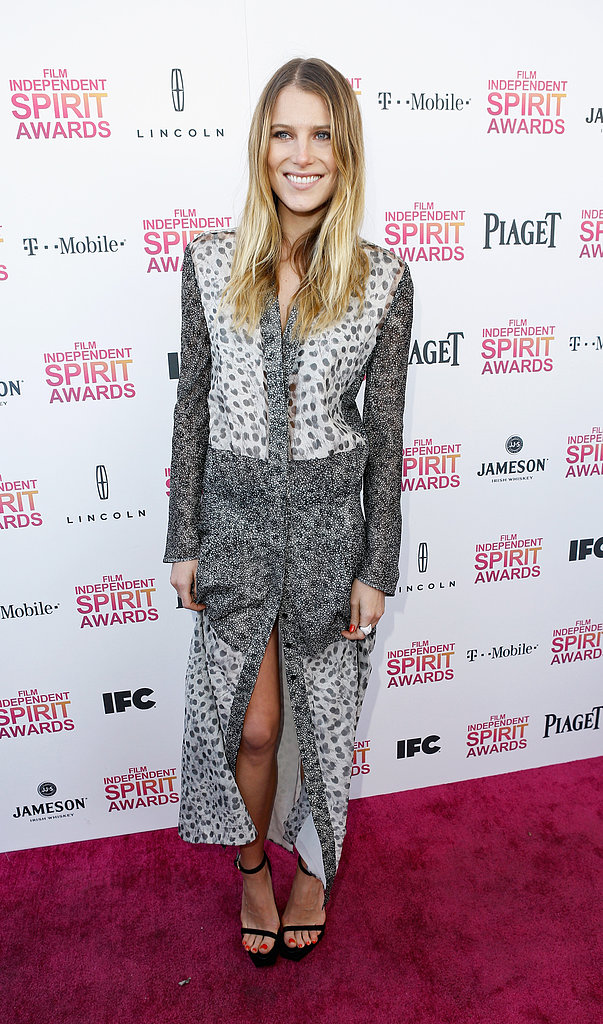 Dree Hemingway revealed a little leg in a floor-length printed dress from Calvin Klein Collection Resort 2013 and paired it with simple black sandals, also by Calvin Klein.