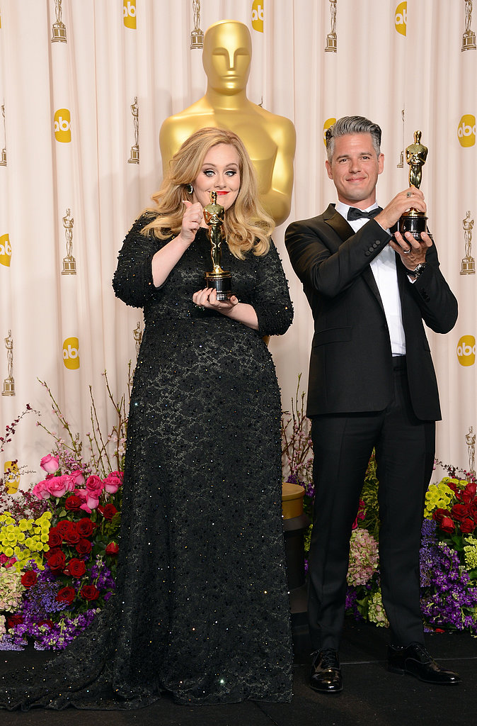 Adele and Paul Epworth posed together with their Oscars.