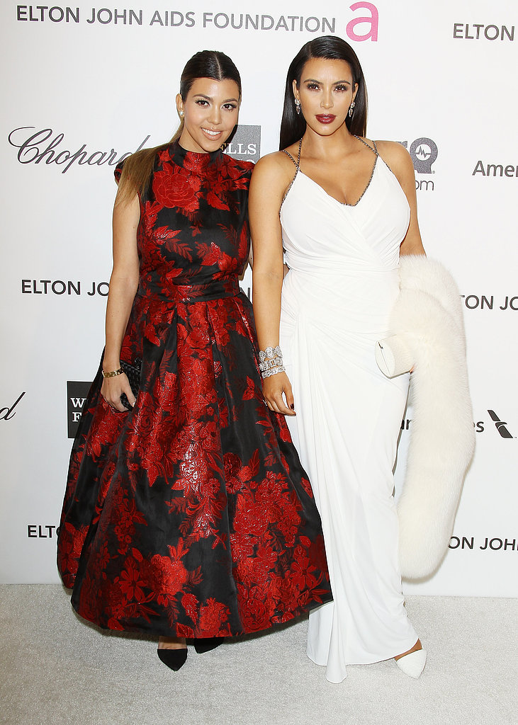 Kourtney Kardashian and Kim Kardashian walked the white carpet.