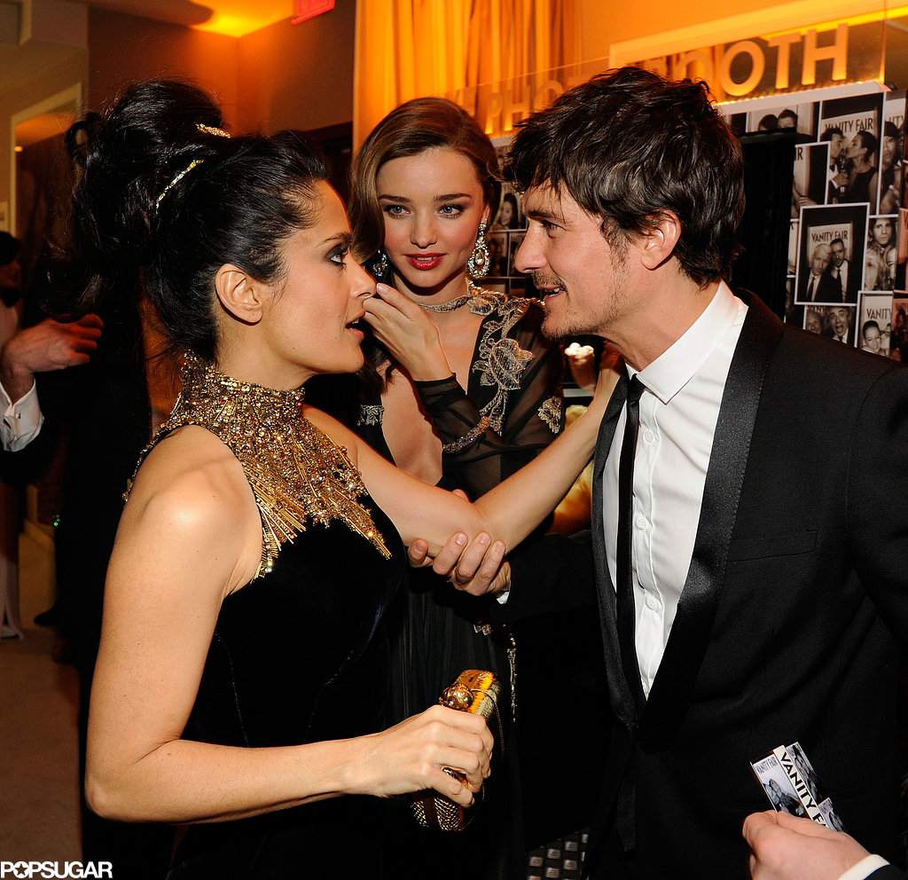 Salma Hayek greeted Orlando Bloom and Miranda Kerr at Vanity Fair's Oscar afterparty.