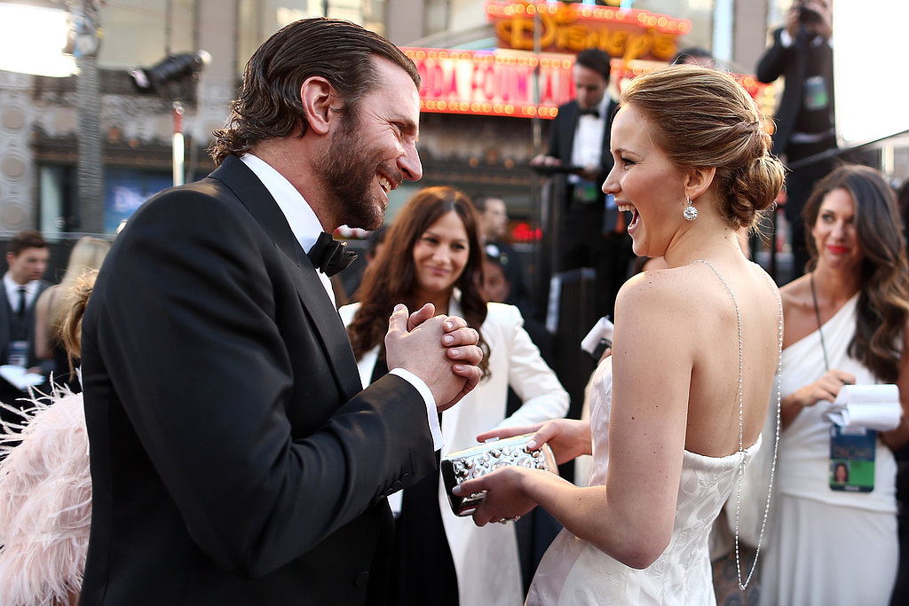 Bradley Cooper and Jennifer Lawrence on the red carpet at the Oscars 2013.