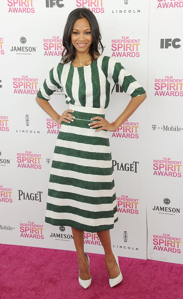 At the 2013 Independent Spirit Awards in Santa Monica, CA, Zoe Saldana was nautical in a green-and-white Dolce & Gabbana dress and white Casadei pumps with matching green piping.