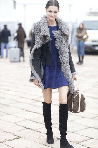 Shearling lining warmed up this little minidress — over-the-knee boots provided the cool factor.