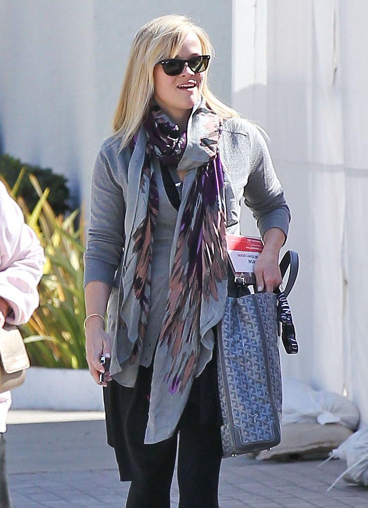 Reese Witherspoon wore a scarf with her gray sweater to attend the TED conference.
