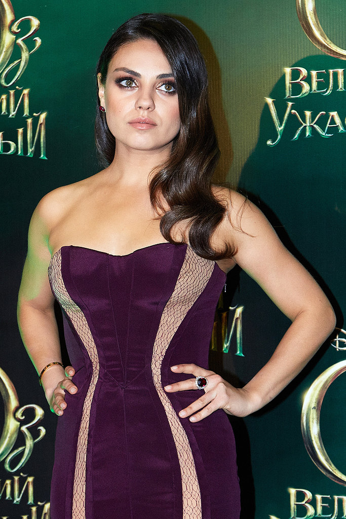 Mila Kunis posed for the cameras at the Russian premiere of Oz the Great and Powerful.