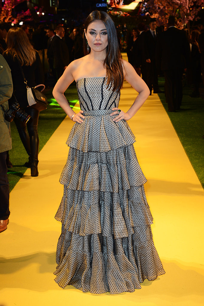 Mila Kunis looked ultrafeminine in a strapless ruffle Alexander McQueen gown at the London premiere of Oz the Great and Powerful.