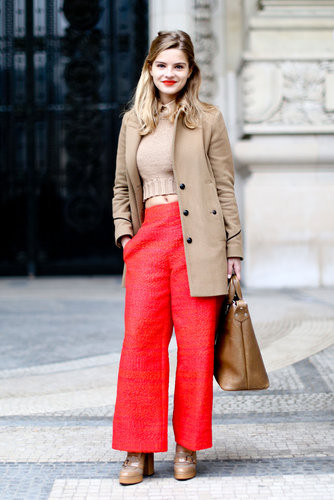 Apple-red lent sweetness to her top and trousers.