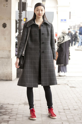 A great coat anchored this ensemble, while sneakers gave it color.